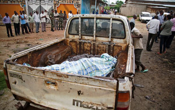 The body of a domestic worker who was shot by the police lay in the back of a truck in Musaga, a neighborhood of Bujumbura, the capital, in January. GRIFF TAPPER / AGENCE FRANCE-PRESSE — GETTY IMAGES