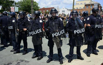 Riot police at protests in Charlottesville, USA, in August 2017. Image: Stephen Melkisethian/Flickr. Some rights reserved.